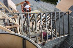 Model maker building timber frame