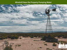 Windmill Near the Property Pumping Water