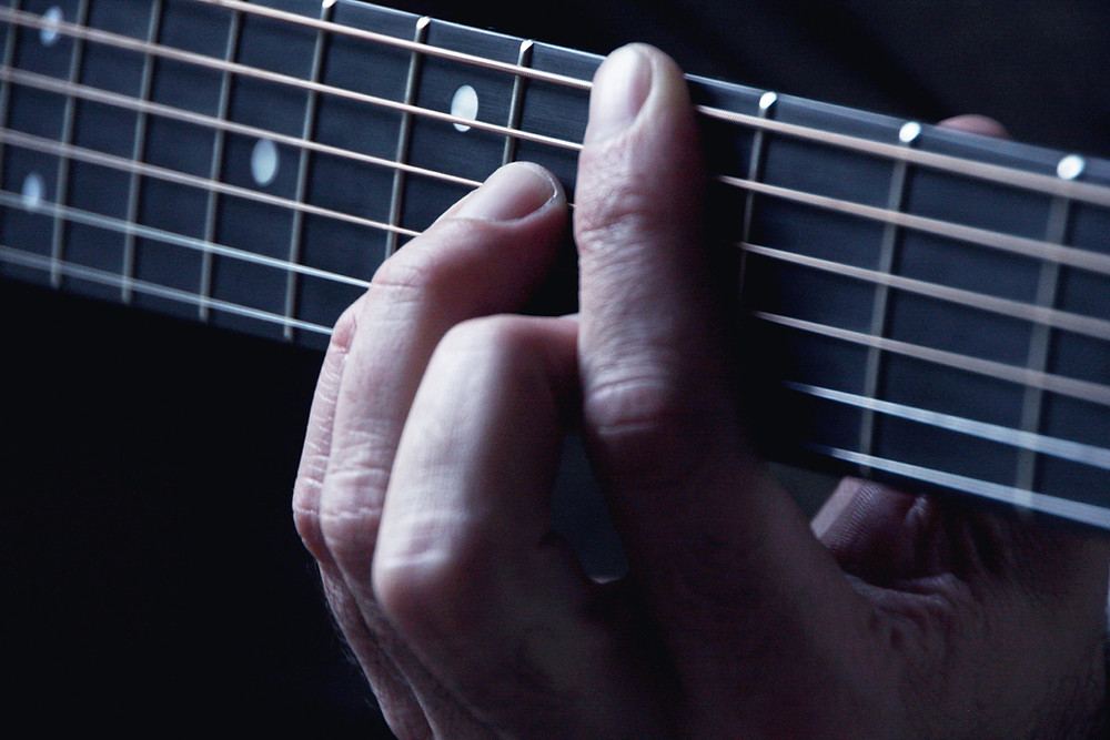 hand on guitar