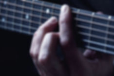 Close up on hands in chord position