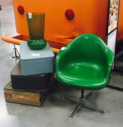 GREEN MCM CHAIR WITH SUITCASES