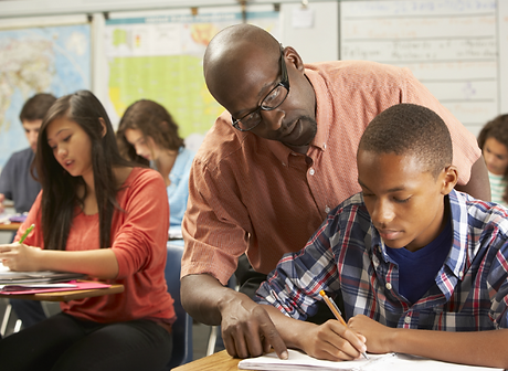High-School---black-teacher-helping-student---kids-in-class---680.png