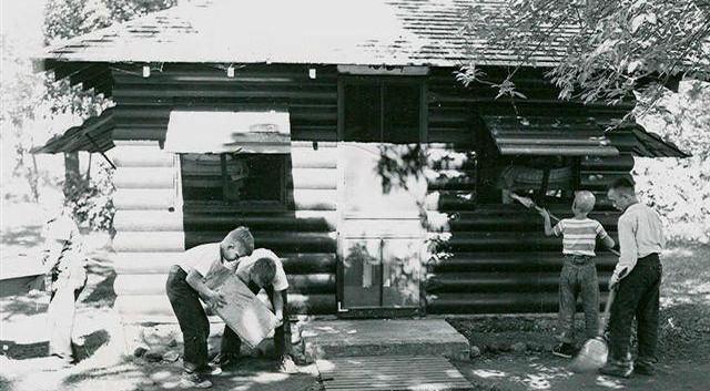 Boys cleaning cabin (1).jpg