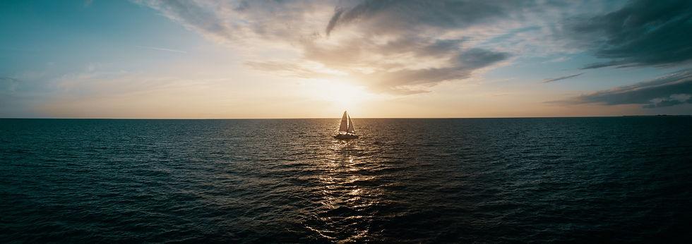 Sailboat on Lake at Sunset