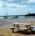 Picnic table at Big Water Marina campround with view of Lake Hartwell