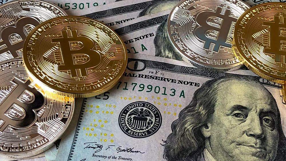 Bitcoins and Dollar Bills.