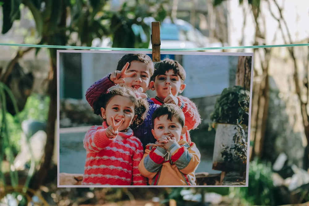 A photo of four children in Aaqrabâte, Syria.