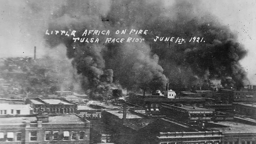 Greenwood District in Tulsa, OK, set on fire by armed mobs in 1921.