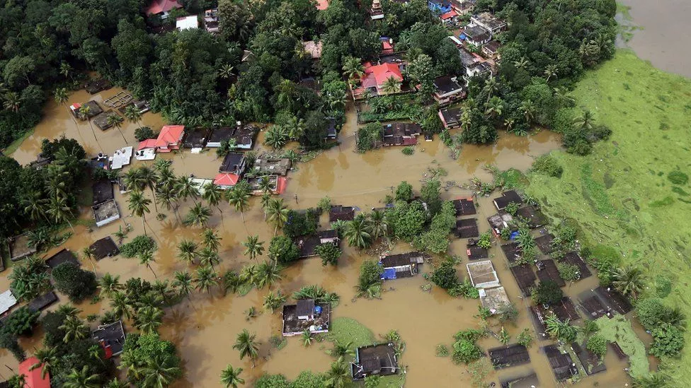 Partially submerged houses during the 2018 floods in Kerala, India.