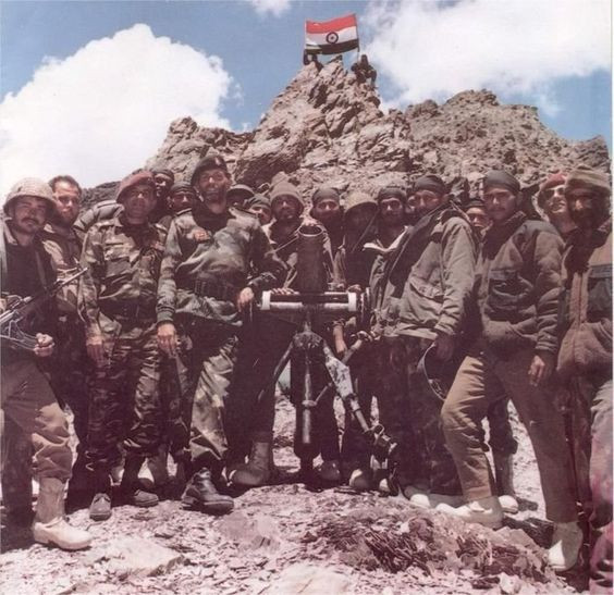 Indian soldiers hoisting flag after the victory.