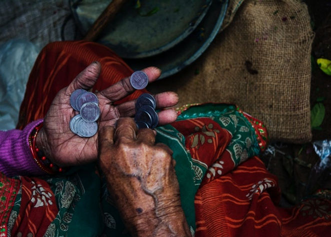 person-holding-coins-874684 (1).jpg