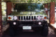 H2 Hummer Limo with the reflection of grape vines on the bonnet on a wine tour