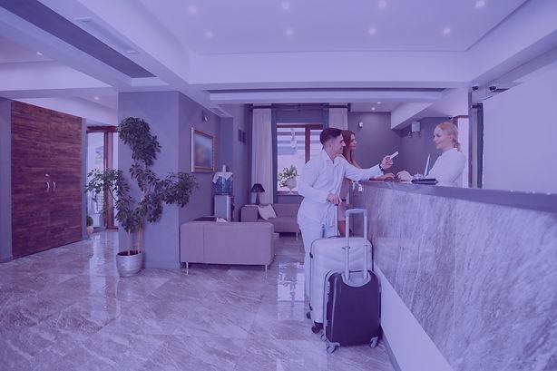 couple-near-reception-desk-in-hotel_edit