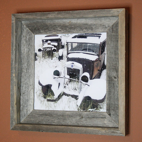 Snow Covered Old Automobiles