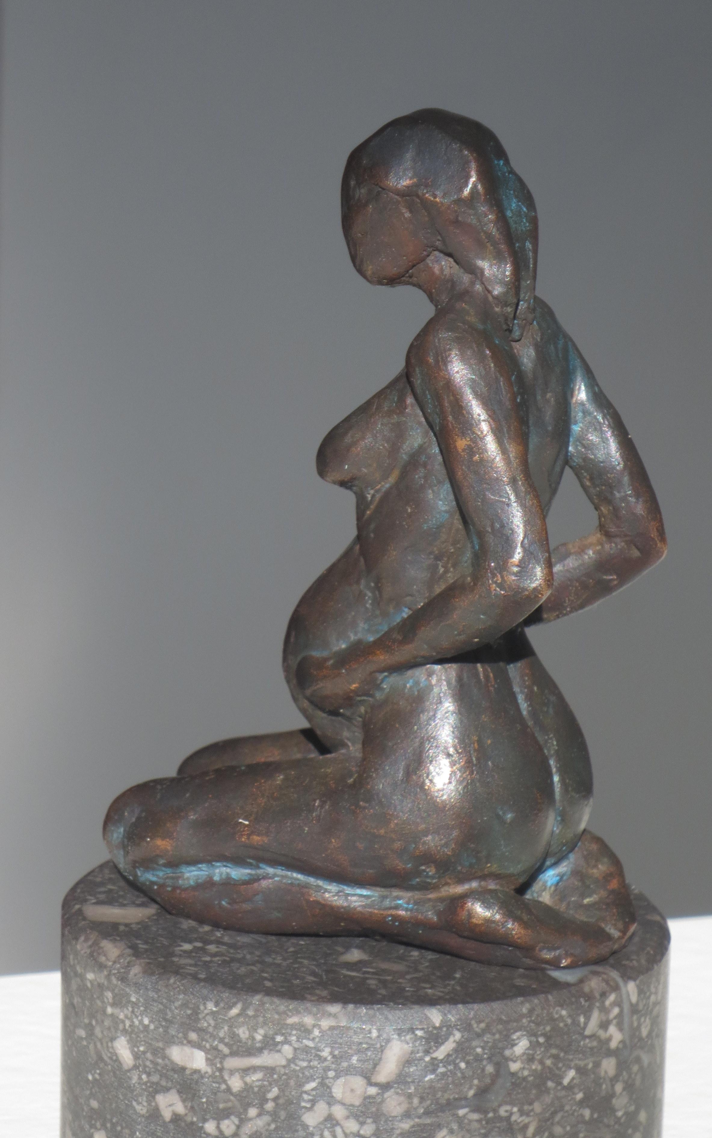 Zwangere zittend