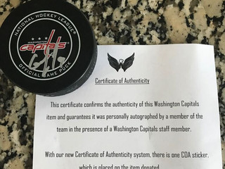 NHL Capitals game puck auction. Signed by #9 Dmitry Orlov. Comes with certificate of authenticity AN