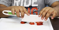 student cutting strawberies.image.jpg