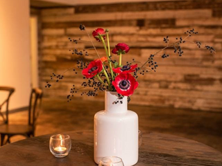 Corporate+Events|CentricsIT+Adapture+Holiday+Party+The+Stave+Room|Red+Anemonies+Bring+A+Bright+Cheerful+Glow+To+These+Wood+Highboys.PNG
