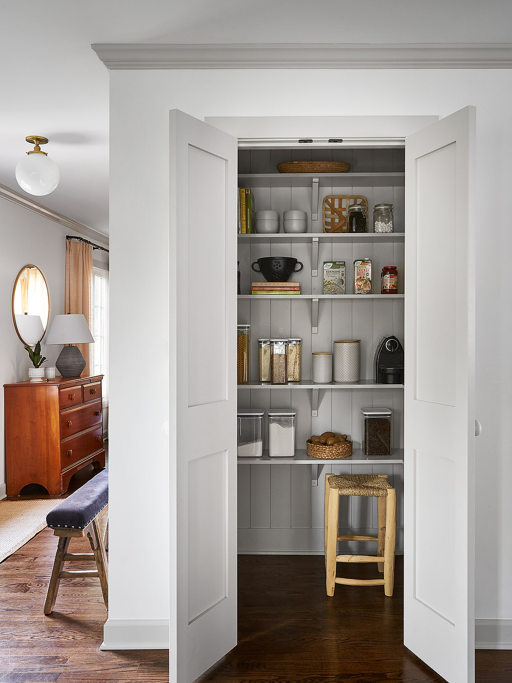 pantry with tongue and groove paneling