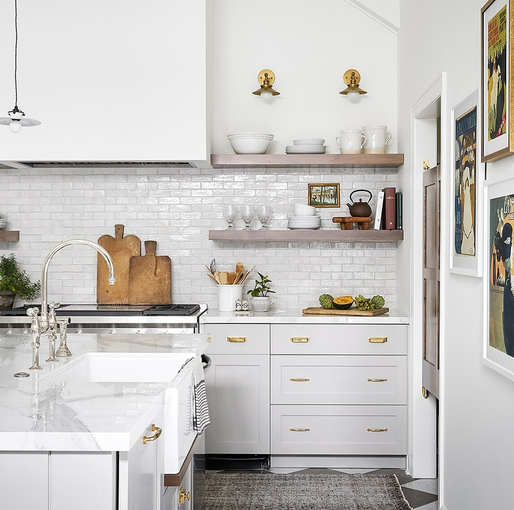 kitchen with open shelving and mixed metals
