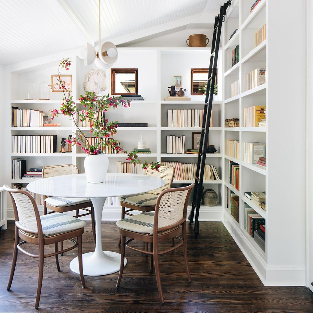 white bookshelves in dining nook