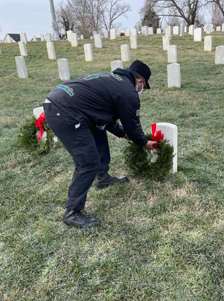 Adonis laying wreaths @ WAA event