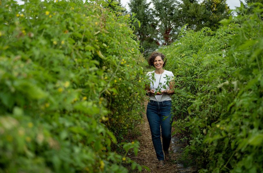 Nutritionist in organic tomato field