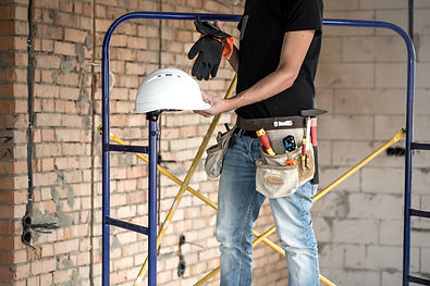 builder-handyman-with-construction-tools