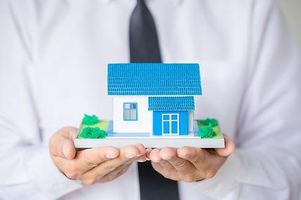 businessman-holding-model-house.jpg