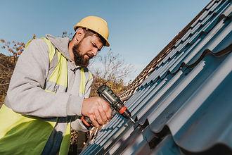 sideways-man-working-roof-with-drill.jpg