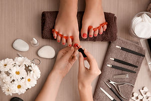 Young woman getting professional pedicur