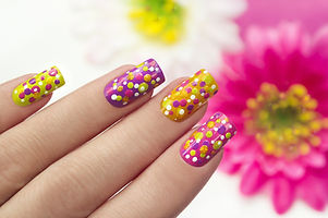 Colorful manicure with points on a li