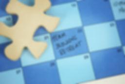 "A calendar with the words ""Team Building"