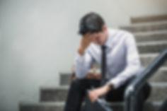 Portrait of an upset businessman at desk