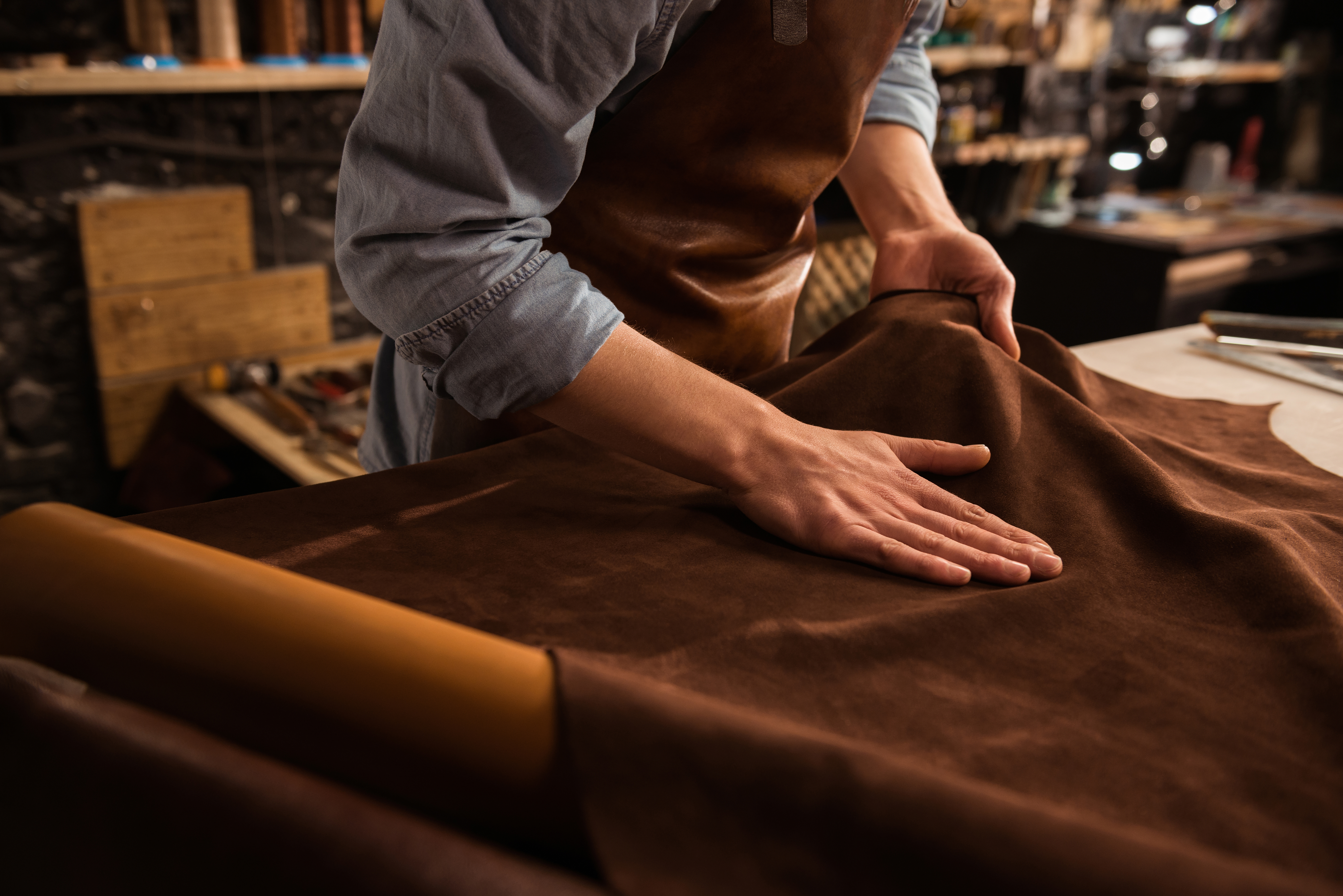 Close up of a male shoemaker working wit
