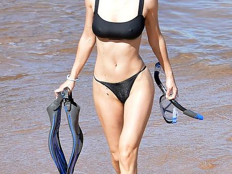 Alexandra Daddario showcases her fit figure in black bikini