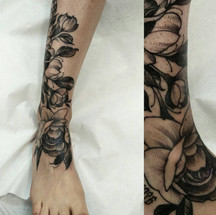 Dot work flower ankle tattoo
