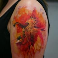 Watercolor phoenix shoulder tattoo