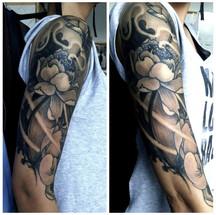 Traditional flower shoulder tattoo