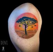 african sunset tattoo