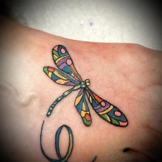 Abstract dragonfly tattoo