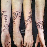 Flower tattoo wrap around foream