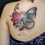 Double exposure skull butterfly rose tattoo
