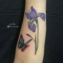 iris butterfly tattoo forearm