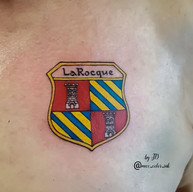 family crest chest tattoo