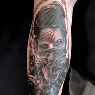 girl with gun tattoo forearm stalbert maximumcolour