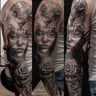 Lion headdress woman warrior rose skull black and grey sleeve tattoo