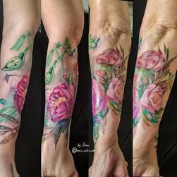 Peonies wild flowers forearm tattoo