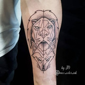Geometrical lion fox foream tattoo