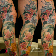 Lilies dolphines color leg tattoo